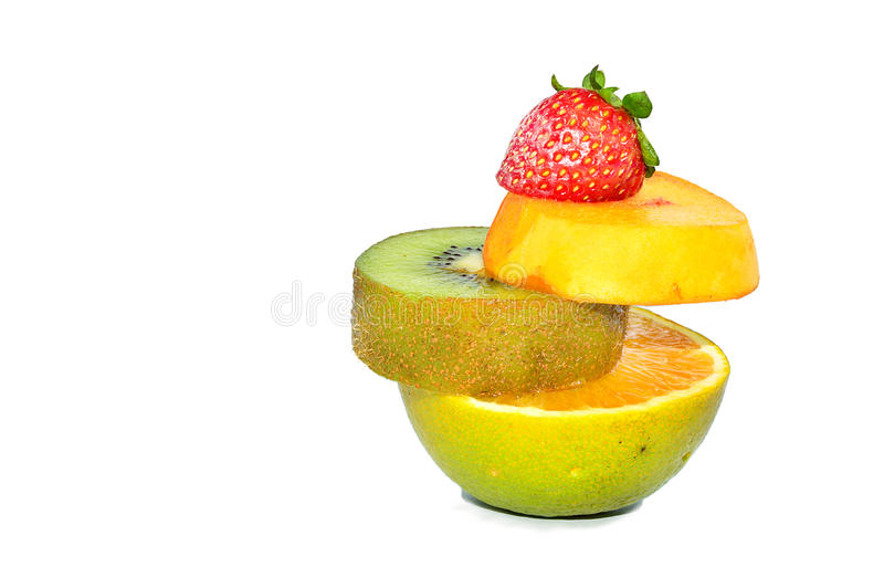 Four fruits in one : Strawberry, Peach, Kiwi and Orange stock images