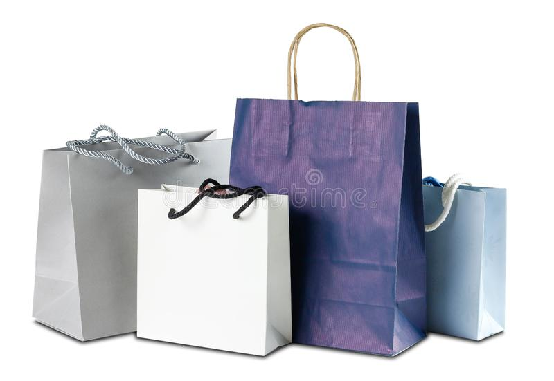 Four gift colored paper bags on white background. Close up royalty free stock photos