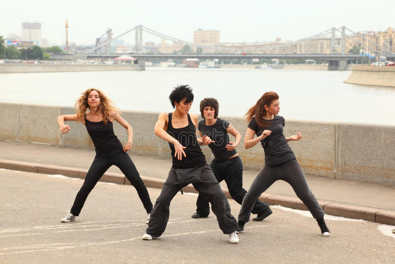 Download Four Girls Dancing On Embankment Stock Image - Image: 19719081