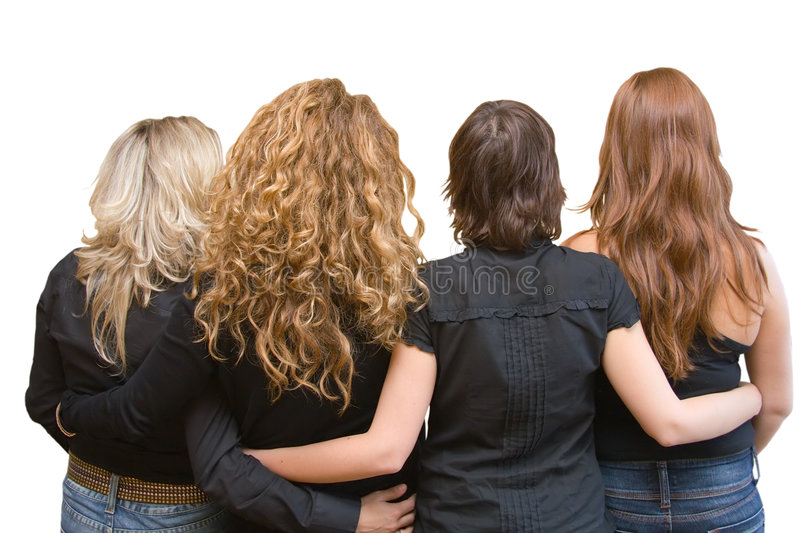 Four girls, four hair colours - linking arms. Four girls, four hair colours - blond, chestnut, brunette, redhead. Linking arms. Casual wear - Black blouses & royalty free stock photo