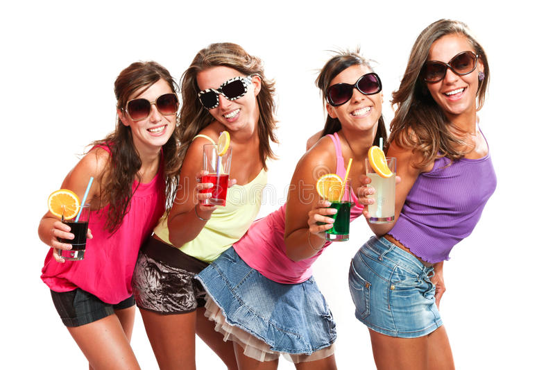 Four girls fun with a drink. Portrait in studio, isolated on white background royalty free stock images