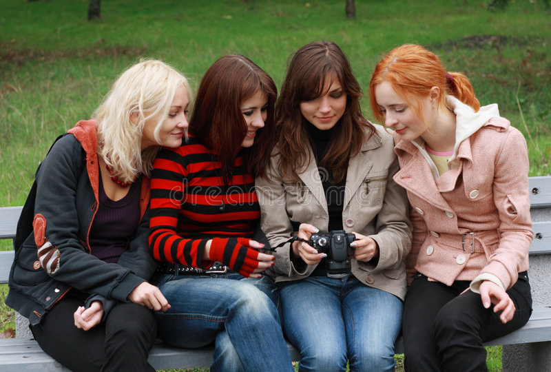 Download Four Girls Having Fun With A Digital Camera Stock Photo - Image of girls, grass: 6934582