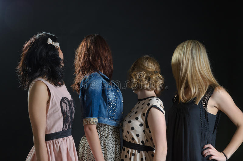 Four girls looking away from stock photo