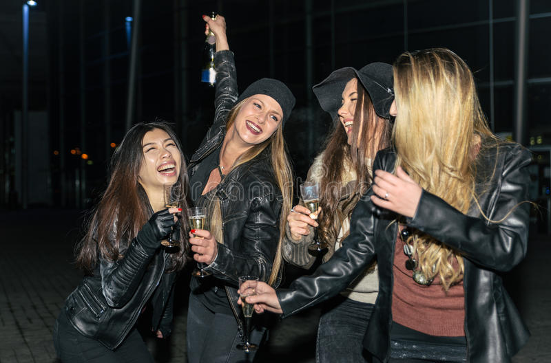 Four girls making party outdoor. In the night stock photo