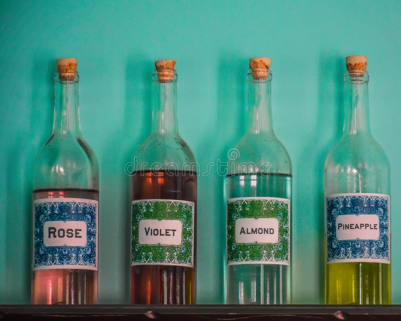Four Glass Bottles Teal Wall royalty free stock images