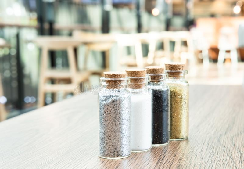 Four glass bottles of tinsels royalty free stock photo