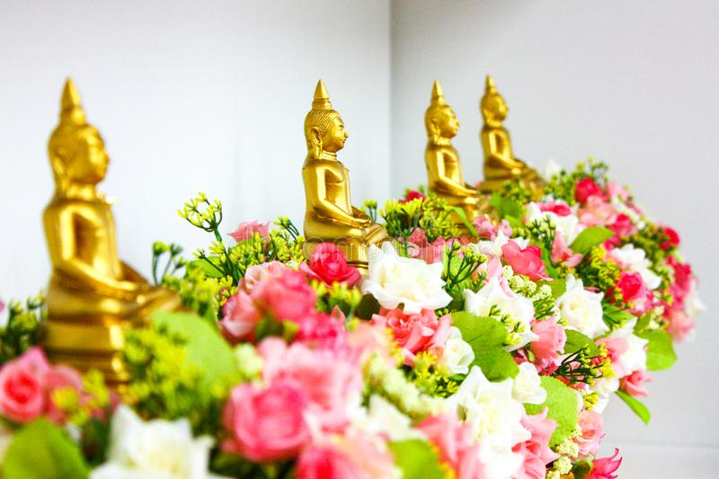 Four gold buddha on the flower in the row stock images