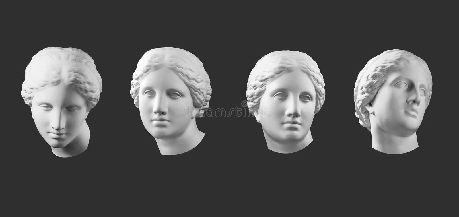 Four gypsum copy of ancient statue Venus head isolated on black background. Plaster sculpture woman face. Four white gypsum copy of ancient statue of Venus de royalty free stock photography