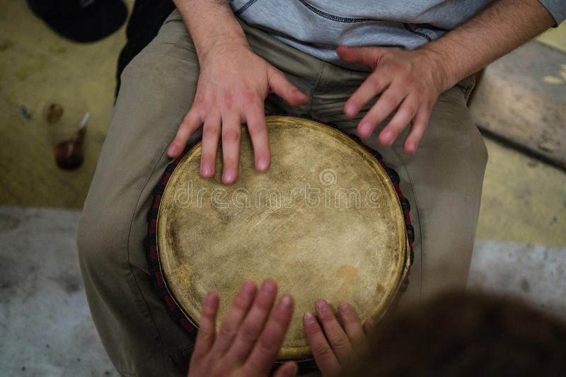 Four hand drumming stock photography