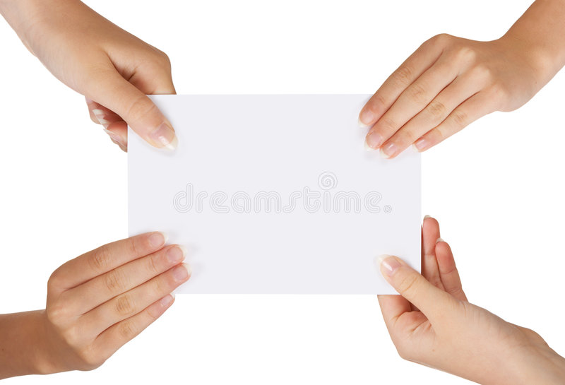 Four hands. Four female hands holding a white card with copy-space