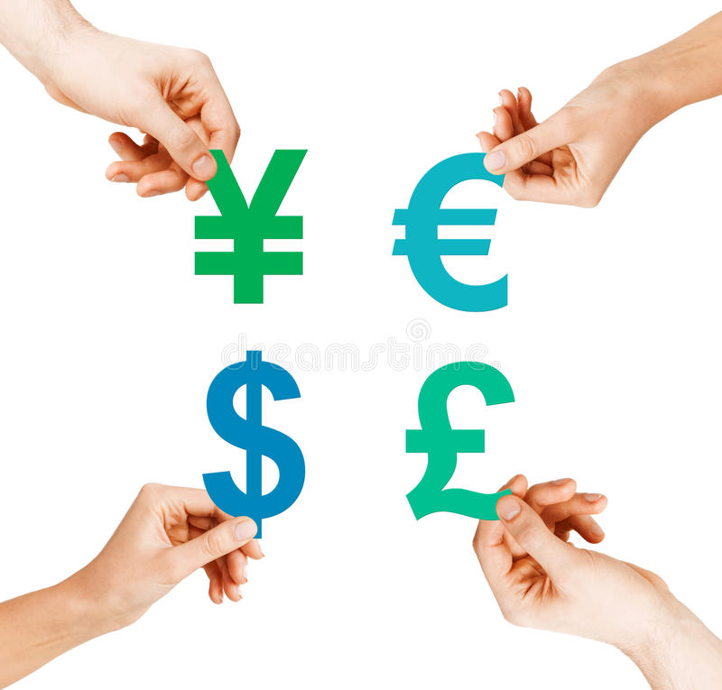 Four hands holding currency symbols stock photos