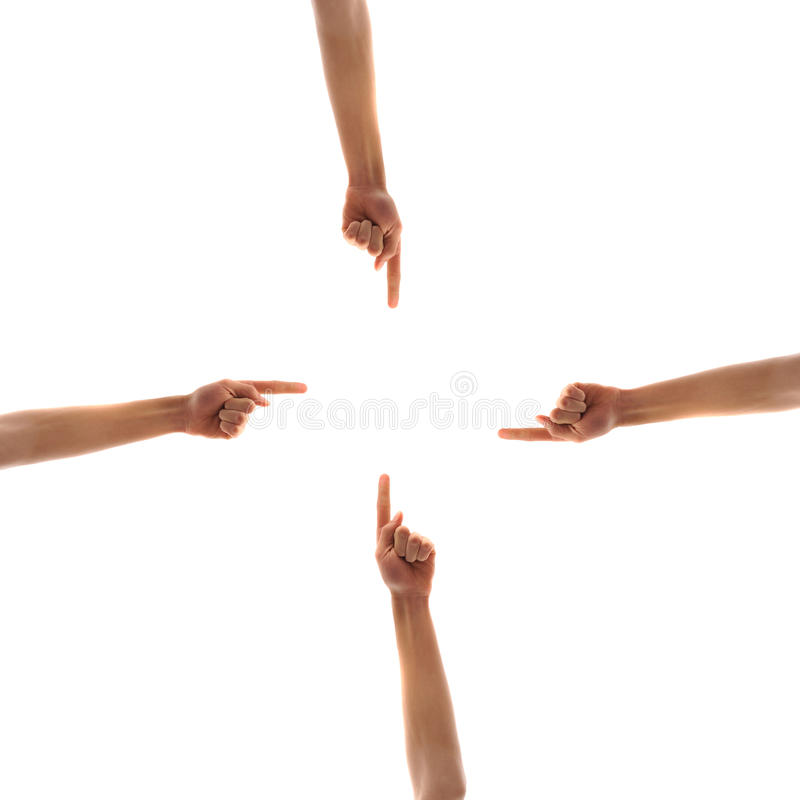 Four Hands Pointing To Center Royalty Free Stock Images