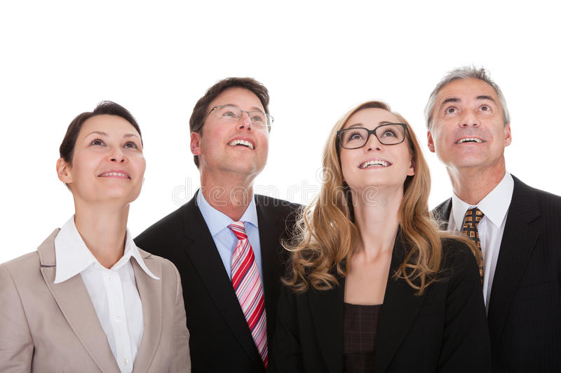Four happy business partners looking up royalty free stock photos