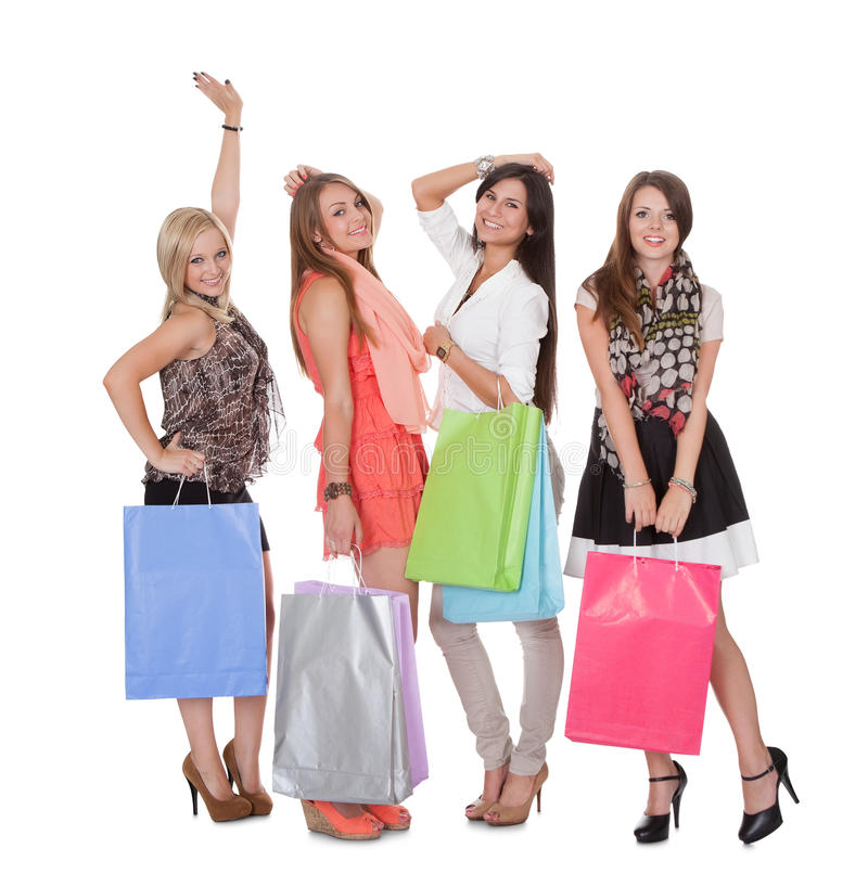 Four happy female shoppers royalty free stock images