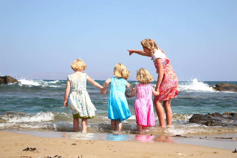 Four happy girls. Playing outdoors stock photo