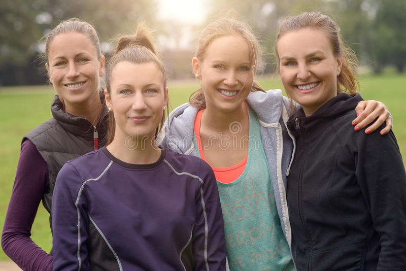 Four Healthy Women after outdoor exercise stock images