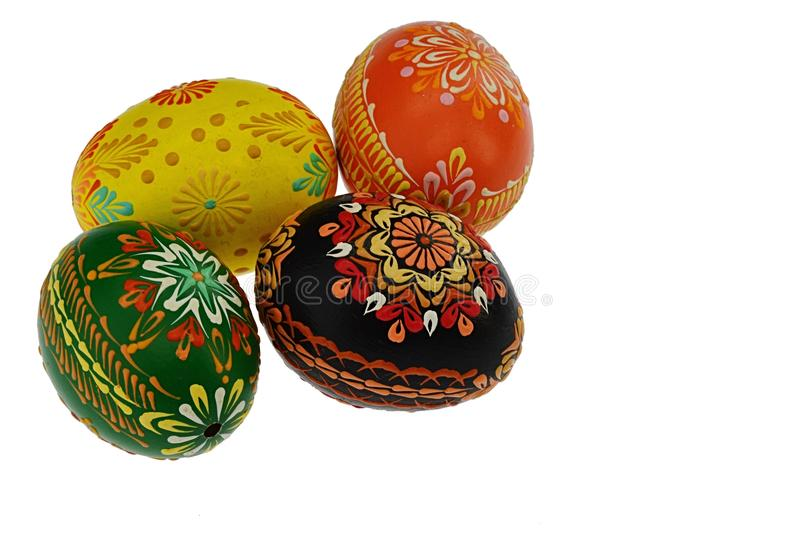 Four home made beautifully painted easter eggs on white background stock photos