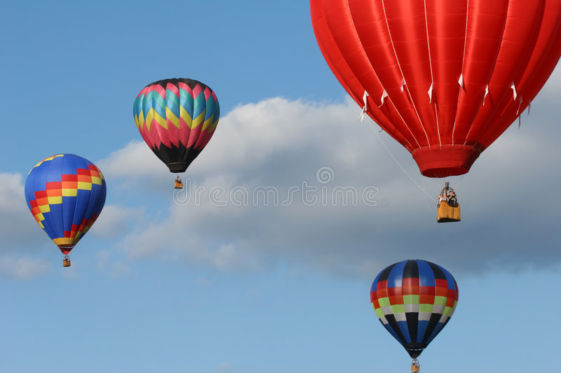 Four hot air balloons stock photo