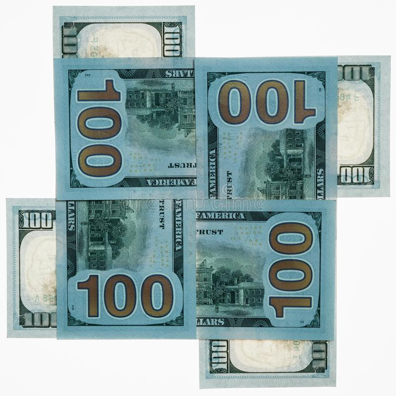 Four hundred-dollar money denominations of the USA on a white background are lined with a cross on each other. Square frame. Busin royalty free stock photos