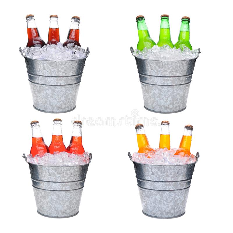 Four ice buckets filled with three soda bottles each. Four ice Buckets Filled with three soda bottles, each pail has a different flavored soft drink, Lemon-Lime royalty free stock image