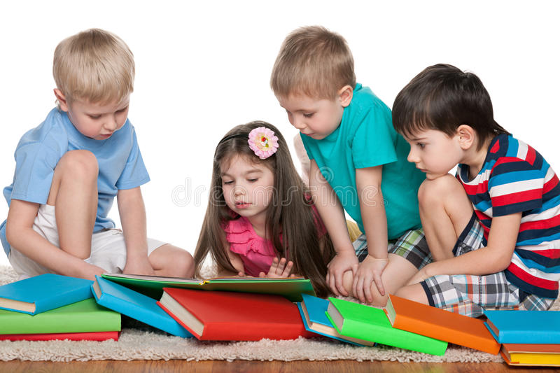 Four kids with books stock images