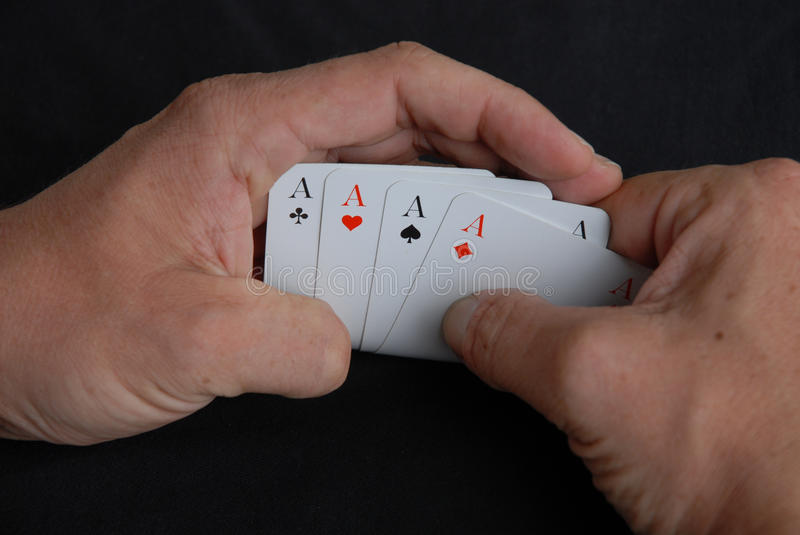 Four of a Kind. The poker winning hand with four aces called 'Four of a Kind royalty free stock photo