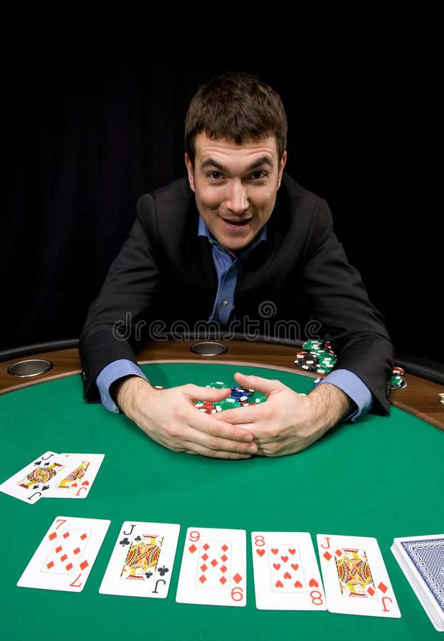Four of a kind. Caucasian man win with four of a kind in casino poker royalty free stock image