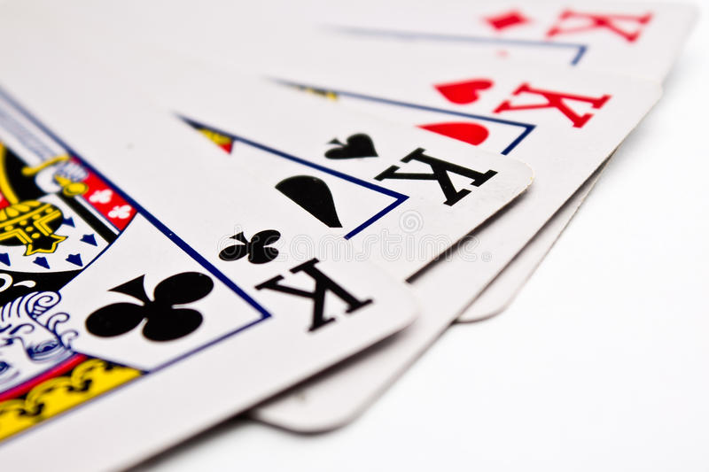 Four kings. Cards closeup on white background royalty free stock images
