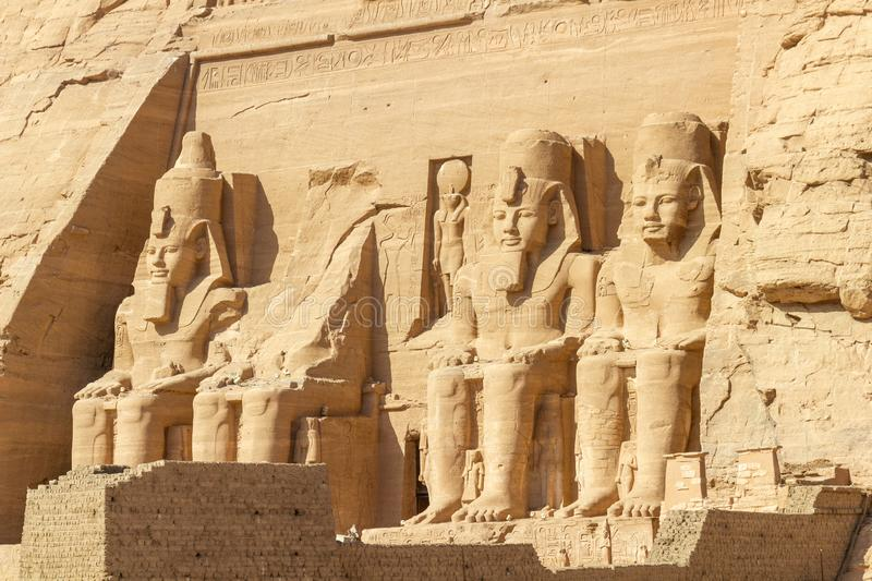 Four large statues of Ramses II at Abu Simbel. Large statues 22 meter high of Ramses II from young left till old right at Abu Simbel stock image