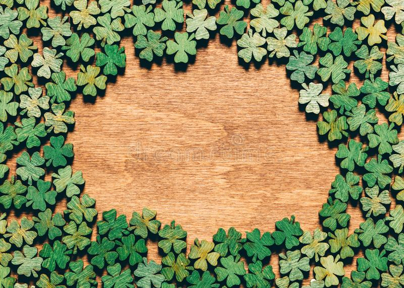 Four-leaf clovers laying on wooden floor royalty free stock image