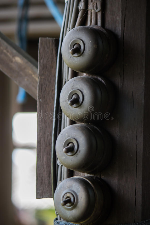 Four Light switches in vintage style. Old style Switches in old Thai house stock photo