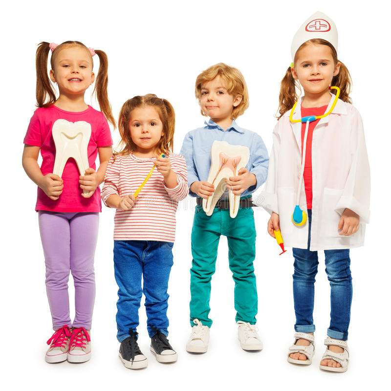 Four little children playing doctors royalty free stock images