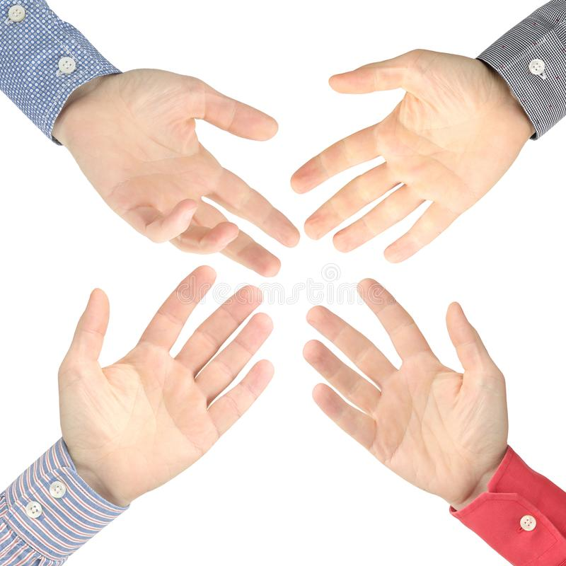 Four male hands stretched out to each other on a white background royalty free stock photography