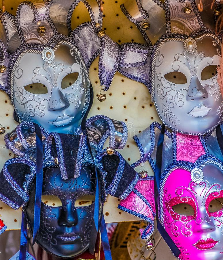 Four Mardi Gras Masks. In a Street Market stock images