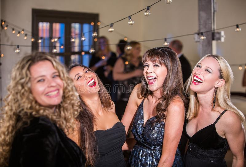 Four Women Laughing Loudly at a Party royalty free stock photo