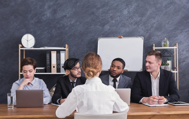 Four members of commission talking with candidate. For job royalty free stock photo