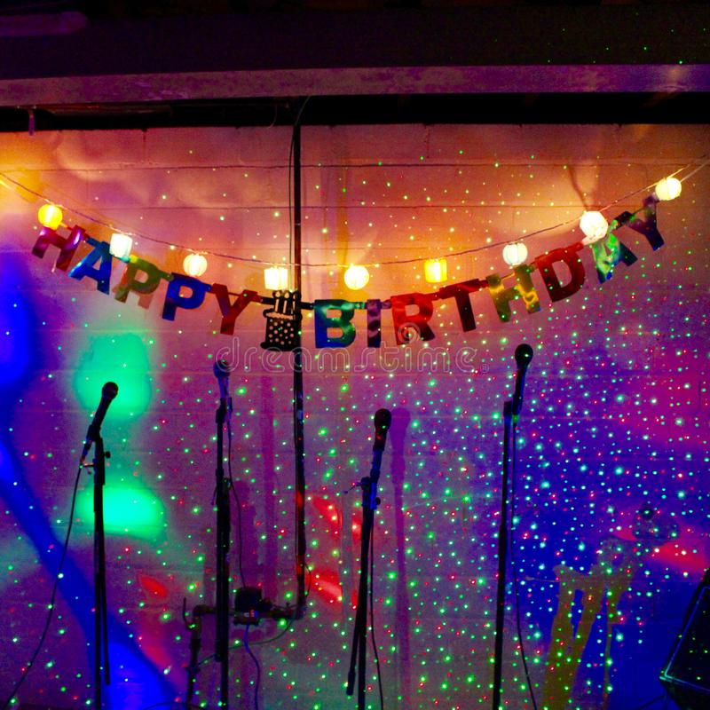 Happy Birthday Song on sparkles. Four mikes up for happy birthday song singing - just step right up to the light at this houseparty delight royalty free stock photo