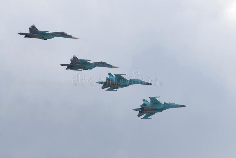 Four military Russian SU-334 planes on a military parade in honor of the Victory Day. ST. PETERSBURG, RUSSIA - MAY 09, 2017: Four military Russian SU-334 planes stock image