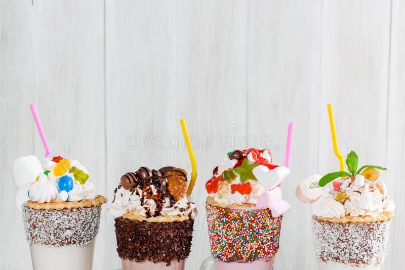 Four milkshakes closeup shot. In the decor stock images