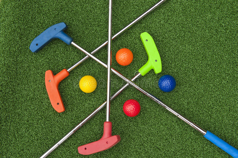 Four Mini Golf Putters and Balls royalty free stock images