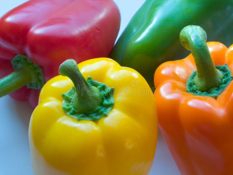 Four Mixed Peppers stock images