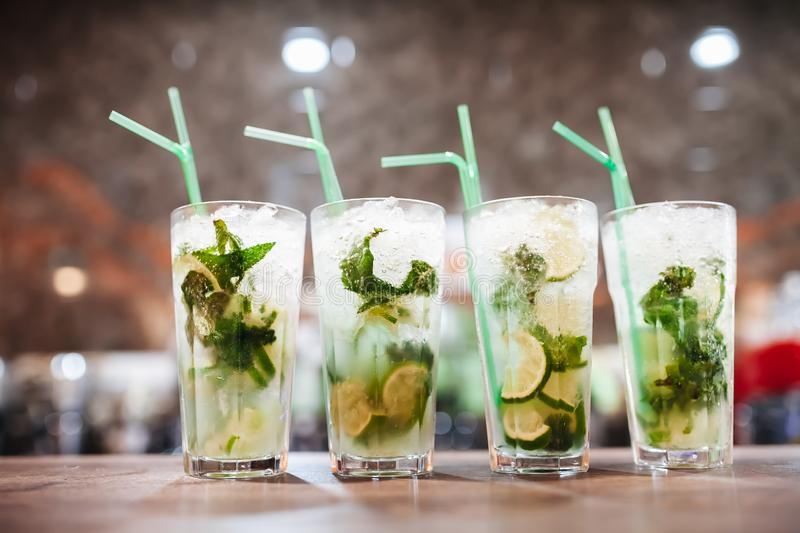 Four Mojito cocktails on a bar counter stock image