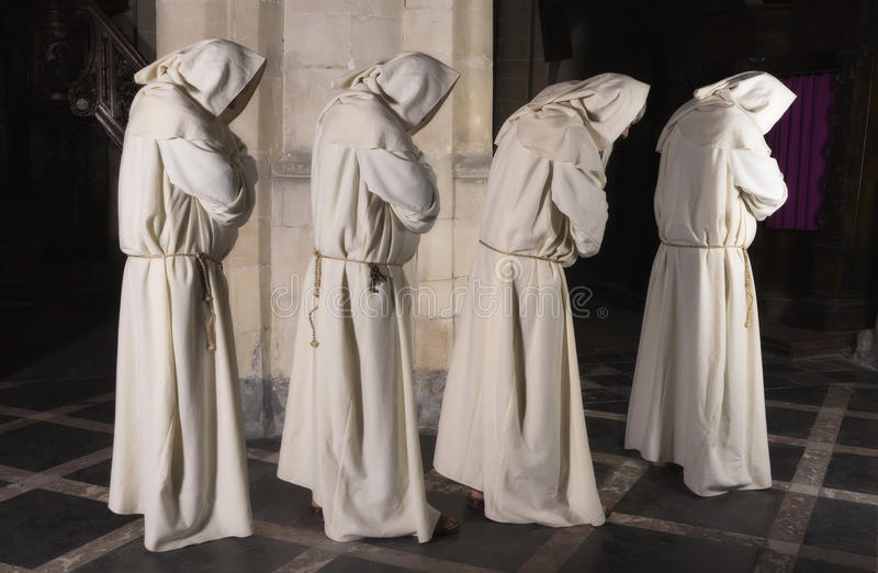 Four monks in a row stock photography