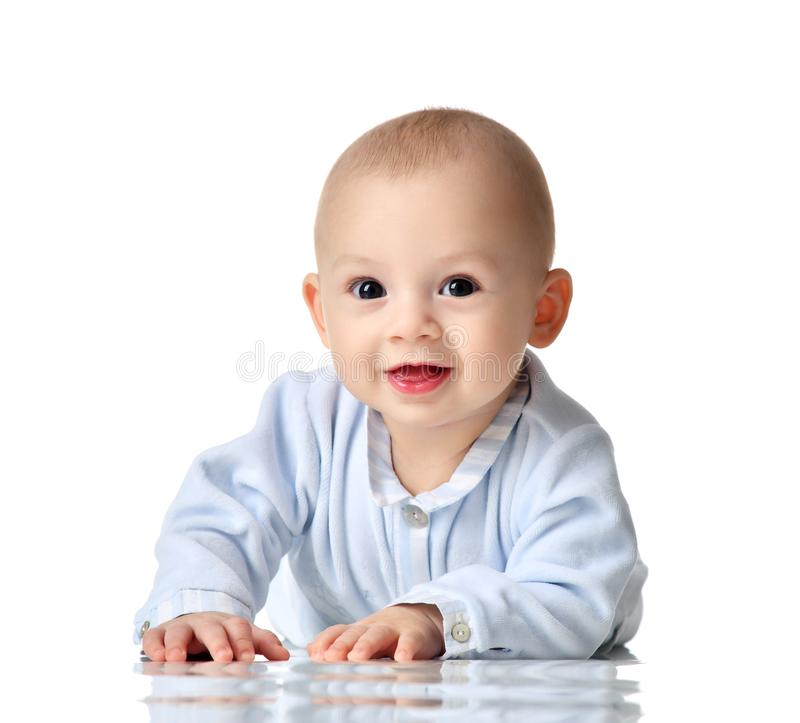 Four month Infant child baby boy in blue cloth lying happy looking at the camera isolated royalty free stock photography