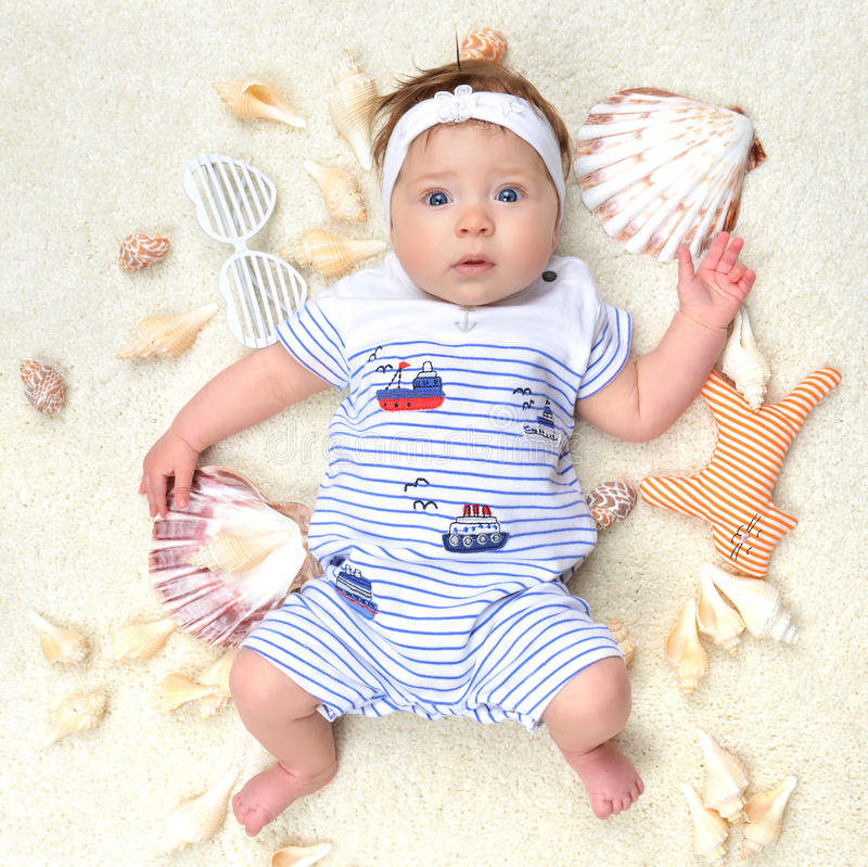 Four month Infant child baby girl lying on a back happy with she stock images
