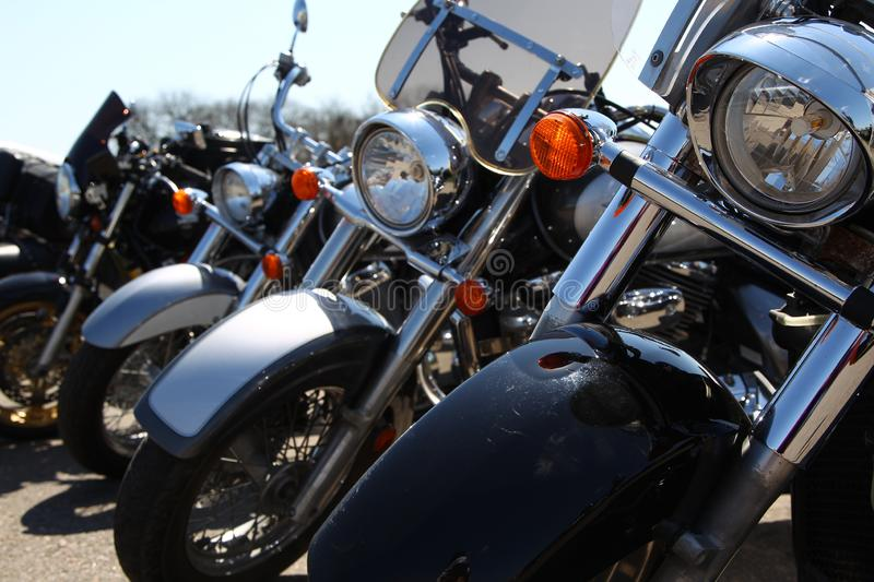 Four motorcycles close-up, standing in a row royalty free stock images