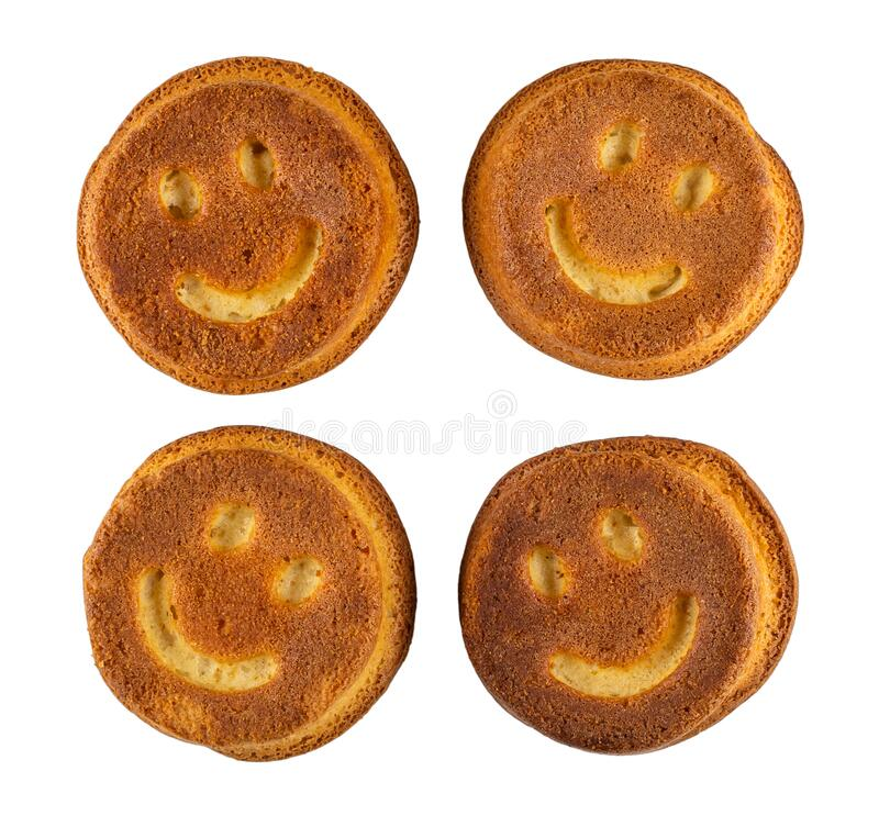 Muffins with smiling face isolated on white. Top view stock photography