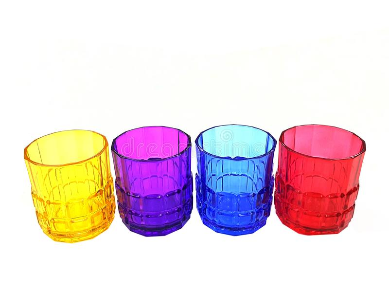 four multi-colored glasses isolated royalty free stock images