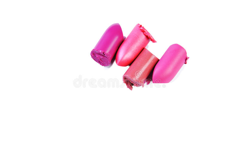 Four multicolor sliced lipstick, isolated on white background royalty free stock image