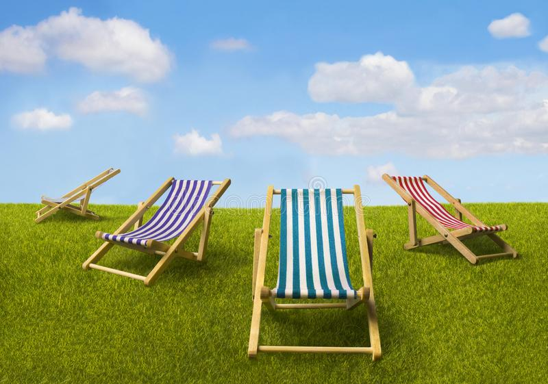 Four multicolored beach chaise-longues royalty free stock photo